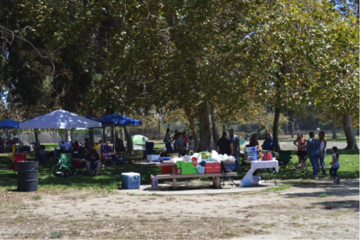 Awnings and food set up in park for outdoor event
