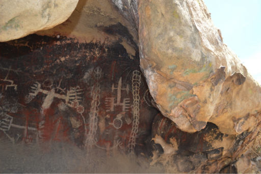 Polychromatic images painted and etched under a natural rock overhang