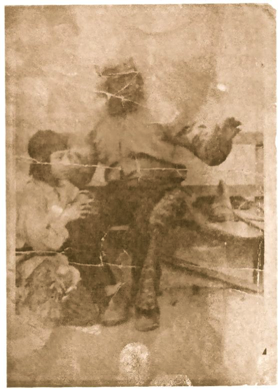 Old sepia-toned photograph of man and young boy in theatrical costumes