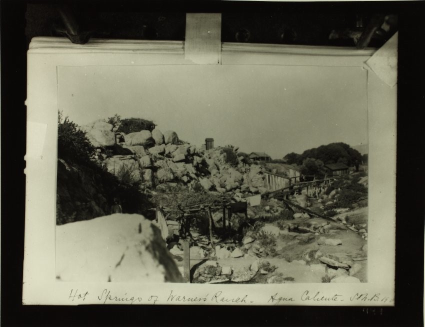 Old photograph of rocky landscape with traditional and 19th-century structures